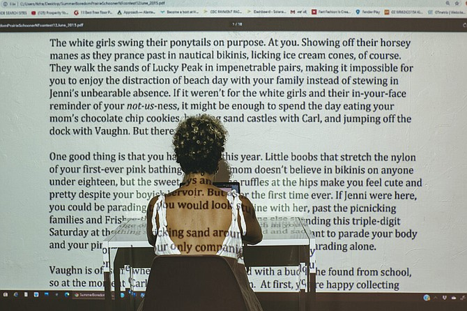 During the three-day performance and exhibition, Salaam will use text in journals, on hanging pages, and on an oversized projection within the space and on the writer herself to invite viewers into her process.