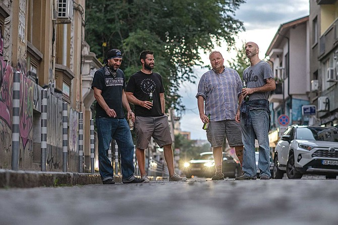 It's perfectly legal for an adult to walk around here with an open alcohol container. Why shouldn't it be? Left to right: Dakata, Dominic, Jarod, and Matt
