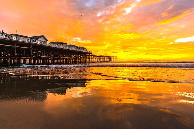 Crystal Pier, Pacific Beach. From the latitude of San Diego, the sun is now setting about 75 seconds earlier every day. - Image by Bonmarito
