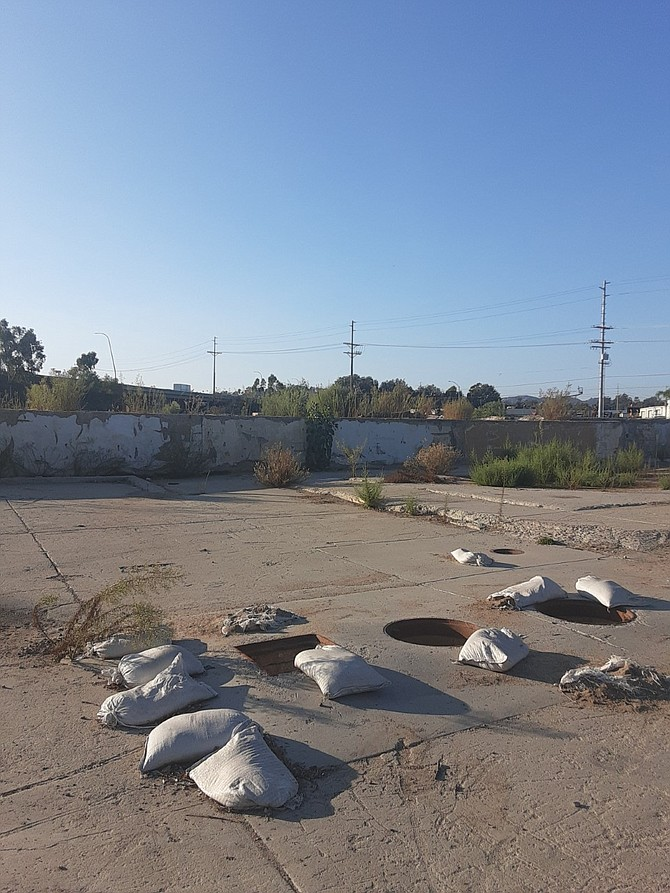 Dirt and sandbags cover what used to be Talone Meat Packing Company
