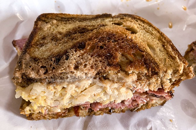 A pastrami sandwich made at butcher shop The Wise Ox