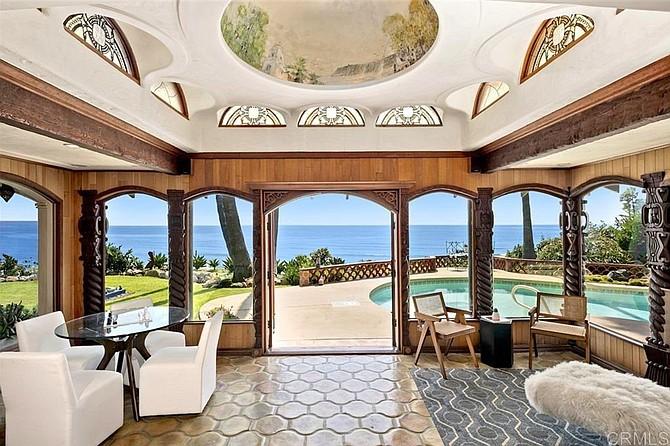 The sunroom: Spanish murals, French doors, California views.