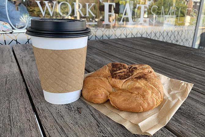 For $1.99 and a smile, Grant's Coffee Room serves coffee and a croissant.