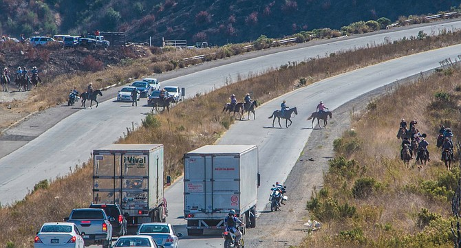 Police stopped incoming and outgoing Tijuana traffic. - Image by Diego Knight