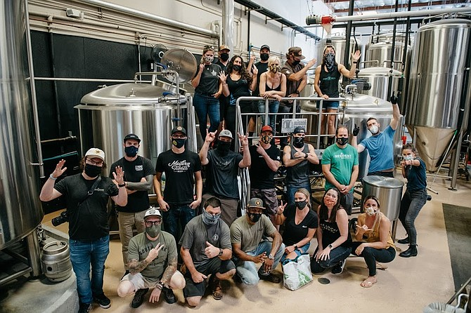 San Diego brewers from several local breweries gathered at Burgeon Beer Co. to produce Capital of Craft IPA, the official brew of San Diego Beer Week. - Image by Oveth Martinez