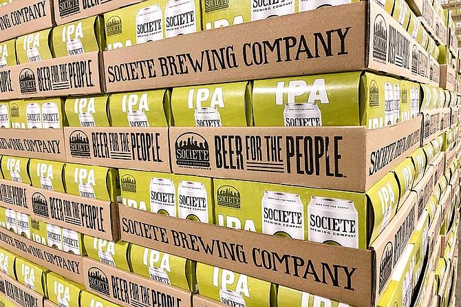 A palette of cans of The Pupil IPA ready to ship from Societe Brewing Company