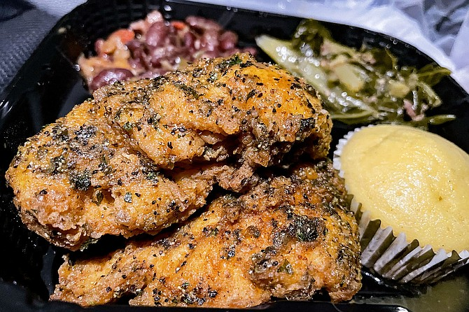 Lemon pepper chicken tenders and sides from Superior Soul Food