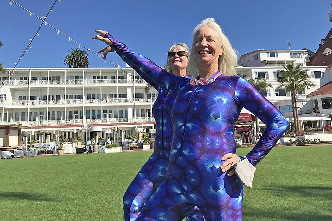 Dani Grady, 62, and Nancy Blair, 63, warm up for an hour's performance of water ballet.