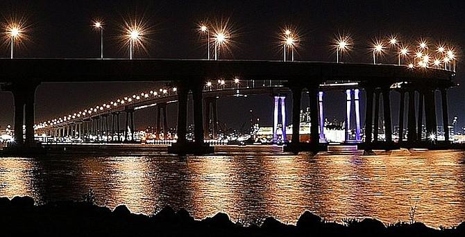 Lights on three of the tallest bridge columns