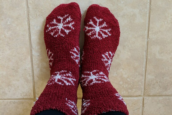 Heather is holiday ready with snowflake socks.