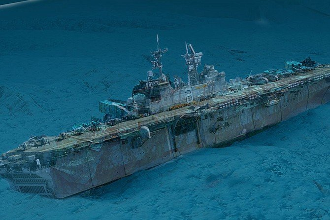 That sinking feeling: the warship will be placed directly below the famed USS Midway as a testament to the Navy's reputation over the past 20 years or so.