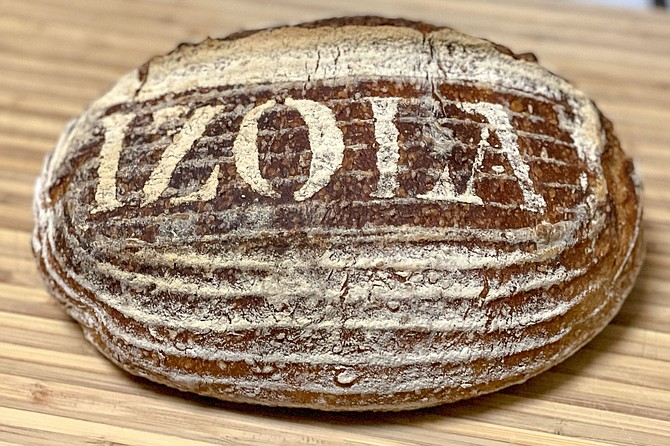 A toasted sesame sourdough loaf made in the home kitchen of a photographer's loft in East Village.
