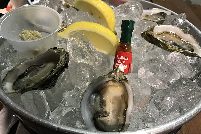 My oysters, with horseradish, Tabasco sauce, lemon, and hot sauce.
