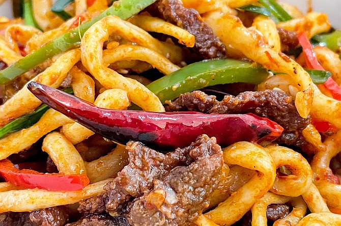Spicy beef laghman noodles: hand-pulled wheat noodles with mild and spicy peppers
