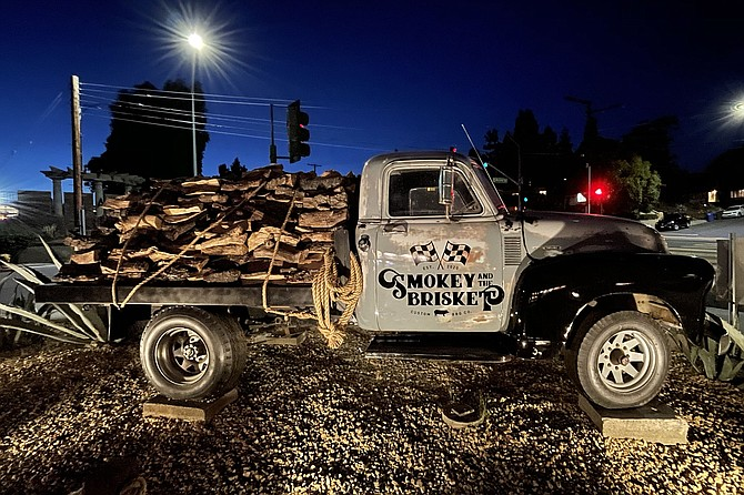 A vintage pickup truck stores wood for the smokers on La Mesa's newest BBQ joint.
