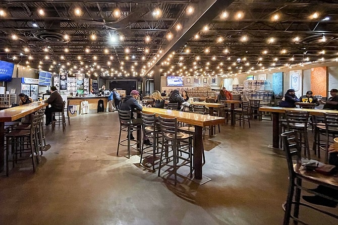 Mike Hess Brewing serves customers in North Park on January 13, while a county-wide on premise service ban remains in effect.