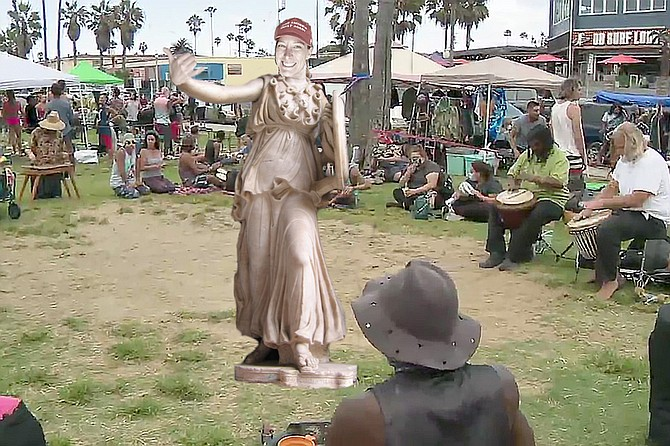 """We modeled our Ashli Babbitt statue after a classical depiction of Athena, the patron goddess of heroic endeavor,"" says Hippy. ""And it seemed fitting to place her in Veteran's Park, where the OB community bravely rallied against the mask mandates and social lockdowns that the Man tried to use to break up our drum circles. It's true that there probably aren't a lot of Trump fans at our gatherings, but Ashli was one of us in spirit, a rebel against a system designed by the Powers that Be to silence the minority viewpoint and keep everyone in line so they can do Business as Usual. The same system that rammed Starbucks down our throats when we were perfectly happy with our local coffee shops."""