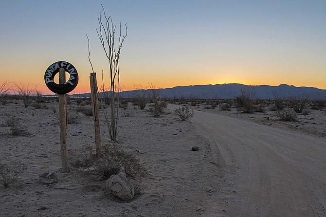 "I spotted a tire mounted on a pole with white letters that read ""Punta Final."" It opened to a dirt road that stretched for more than ten miles until it reached the Sea of Cortez."