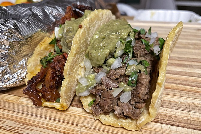 A tri-tip taco and al pastor taco, on thick, handmade tortillas, from Crack Taco Shop in Mission Valley