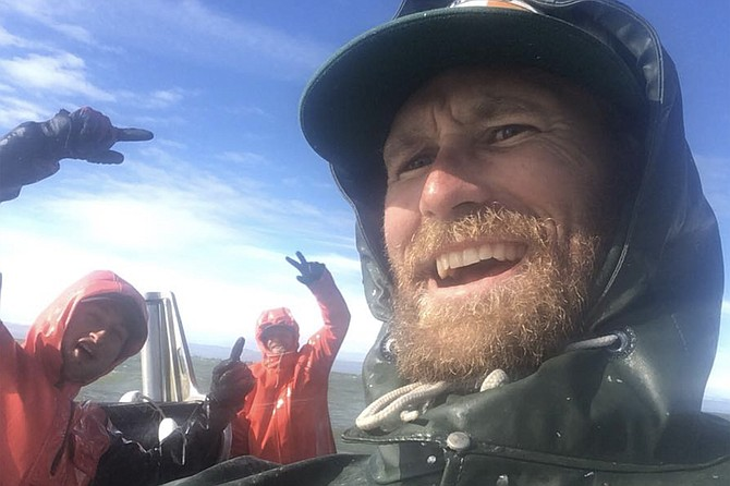 Justin Martin with fellow crew, off Alaska.