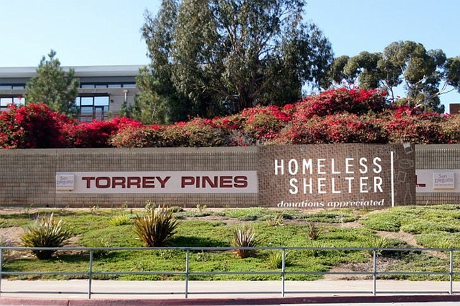 """A banner indicates Torrey Pines High School's new status. Gloria: """"Some of these facilities are really first rate. And the teachers didn't want to go back to in-person instruction, anyway."""""""