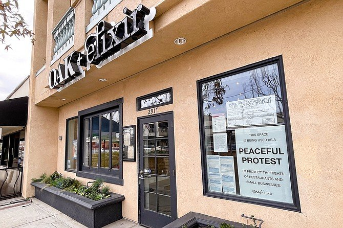 "Carlsbad Village restaurant Oak + Elixir has posted a ""peaceful protest"" notice while remaining open to diners."