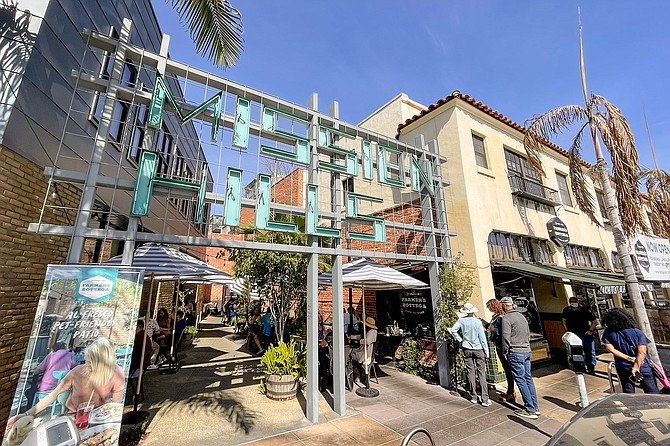 The Mission Hills sign marks the area where Farmer's Bottega diners wait to be seated.