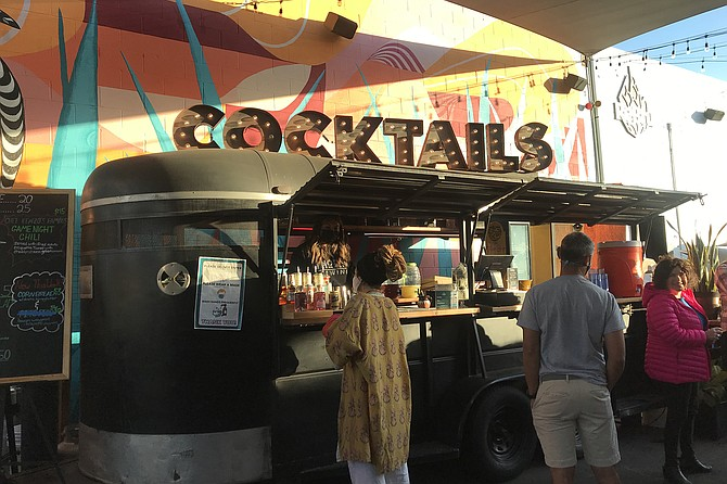 Recyclers: repurposed horse trailer is now the bar