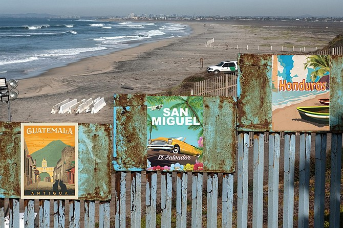 """One prong of the operation involves placing vintage travel posters along the border wall in an effort to get migrants from the Northern Triangle to reconsider the virtues of the places they have left behind. Says Turnback, """"I look at these images and think, 'Who wouldn't want to live there?' It's like the song says: you never know what you've got til it's gone,' or at least until it's 1600 miles behind you. Sure, there are troubles, but you know what? You can't get away from your troubles by running. Or walking, for that matter. You've got to stand and face them. Besides, it's not like we don't have troubles of our own on this side of the border fence. Sure, everybody wants to come live in a country that elected Joe Biden president, especially after he said they should come during the debates. But this is also a country that elected Donald Trump just five years ago. Clearly, we've got some issues, issues that should give anyone pause. Plus, murders are way, way up. So are suicides. You've got mass shootings, hate crimes, systemic racism... Sometimes, I'm amazed we even have to make the case for staying at home."""""""