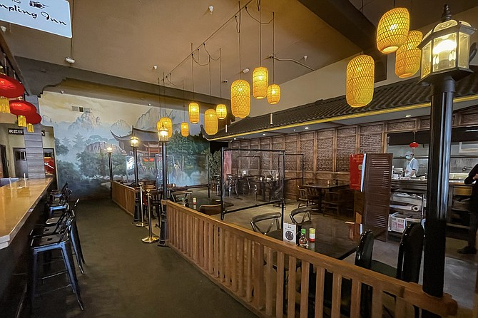 This Dumpling Inn dining room is made to look like the outdoors.