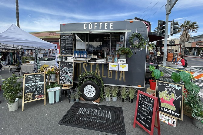 The nostalgia Coffee Roasters coffee cart set up to serve at the Ocean Beach Farmers Market