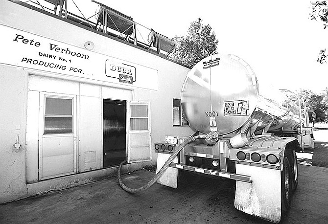 Verboom milks, refrigerates to 34 degrees, and ships out a truckload of milk per day on a truck owned by Land O' Lakes.