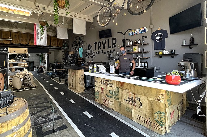 Dan Romeo serves beer, kombucha, and coffee, all made in house, at TRVLR Coffee and One Season Brewing