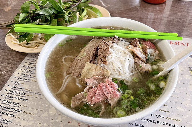 The number 12: beef pho with rare steak and fatty brisket