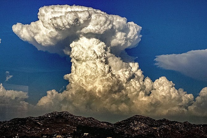Cumulonimbus clouds viewed over mountains from National Weather Service, San Diego