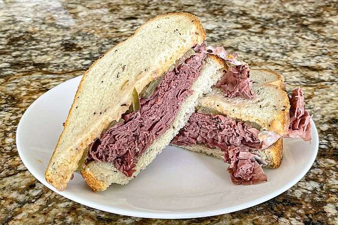 The Double New Yorkers: a pile of steam pastrami with havarti, provolone, pickles, mustard, and thousand island on toasted rye.