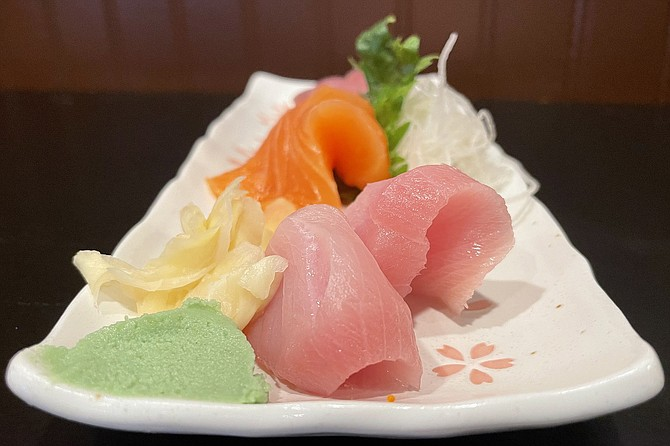 A $12 sashimi combo featuring ahi tuna, salmon, and yellowtail