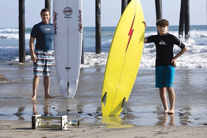 Surf coach Alexander Wells and his student, promising big-wave surfer, 11-year old Ayden Garate.