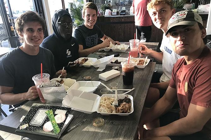 USD's rowing crew bulks up on Korean chicken. (From left) Noah, Anthony, Andrew, Trainer, John.