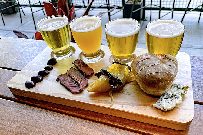A beer pairing board matches elevated bar snacks with select beers.