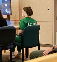 Malissa James in courtroom. Judge ordered her face obscured. Photo by Eva Knott.