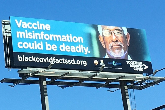 """Above, just one of the many billboards placed around San Diego in an effort to reach the vaccine-hesitant African-American community. Below, one of several followup billboards designed to reach a...different vaccine-hesitant demographic. """"We're not telling them anything they don't already believe,"""" says Spiracy."""