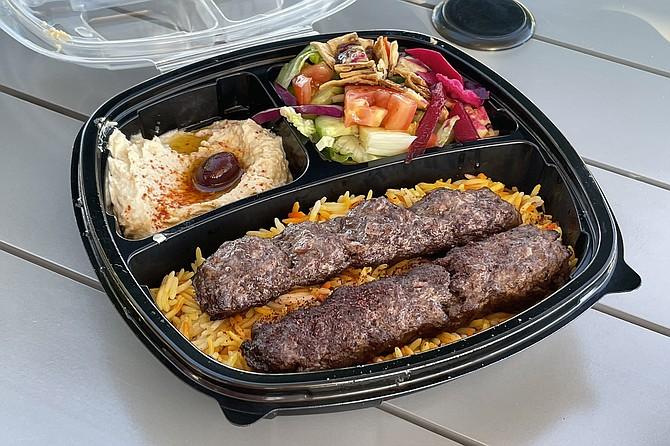 A wagyu beef kabob served over rice