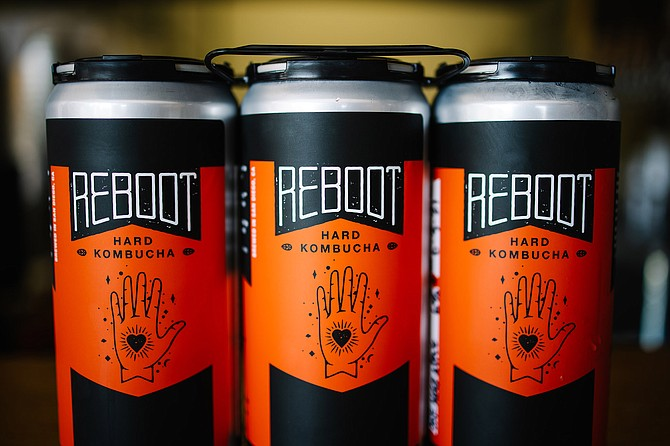 Bootstrap Kombucha serves crowlers of ReBoot Hard Kombucha ahead of a summer can release. - Image by Bree Steffen