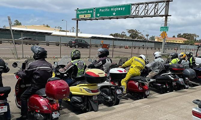 Vespa riders face Pacific Highway