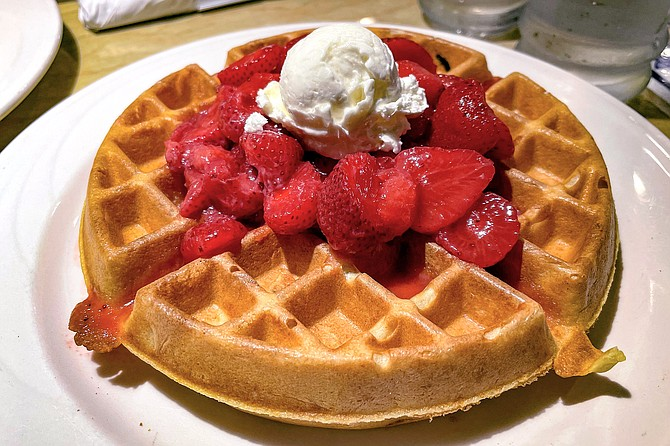 A Spot Waffle, topped with strawberries