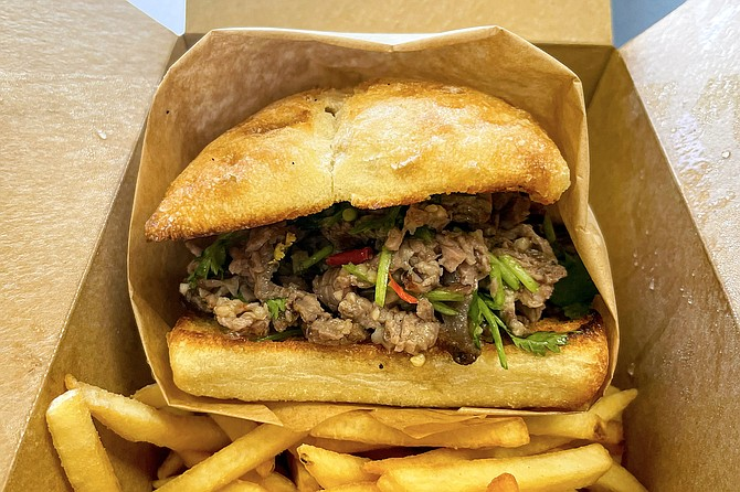 The Steve sandwich features tender, grilled sirloin, chili, vinegar, and cilantro.