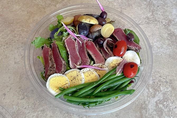 "A ""modern nicoise"" with seared ahi, olive, green beans, potatoes, charred cherry tomatoes, and hard boiled eggs"