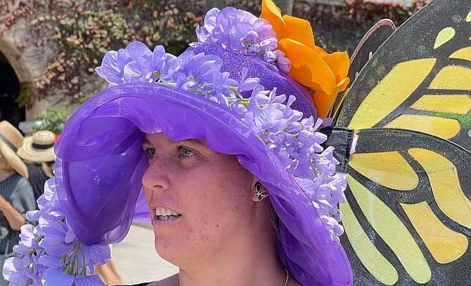 Amber from Escondido wearing butterfly wisteria hat. She's entered opening day hat contest for 10 years.