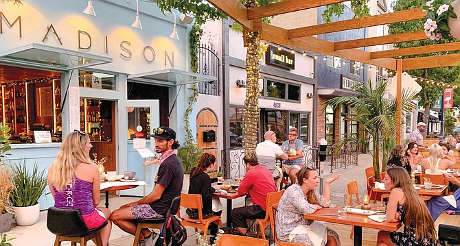 The Madison on Park parklet occupies a half block of what used to be parking spaces along Park Boulevard.
